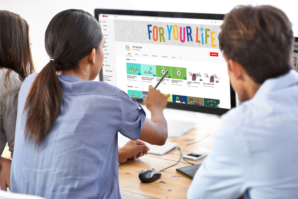 Work team scrolling through the For Your LIfe YouTub e channel